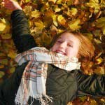 Girl lying on leaves